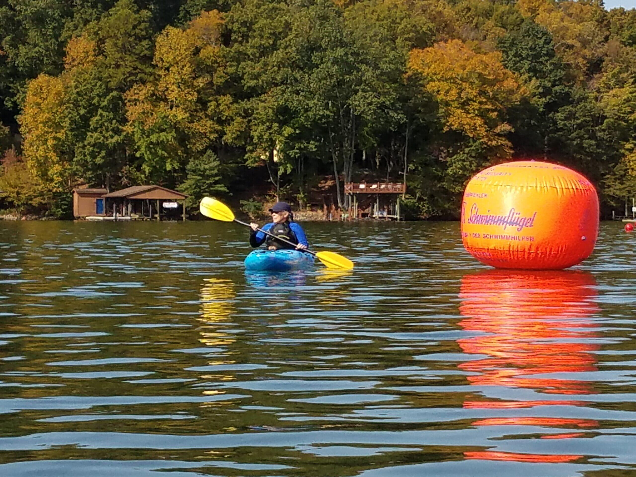 Kayak guy and orange float