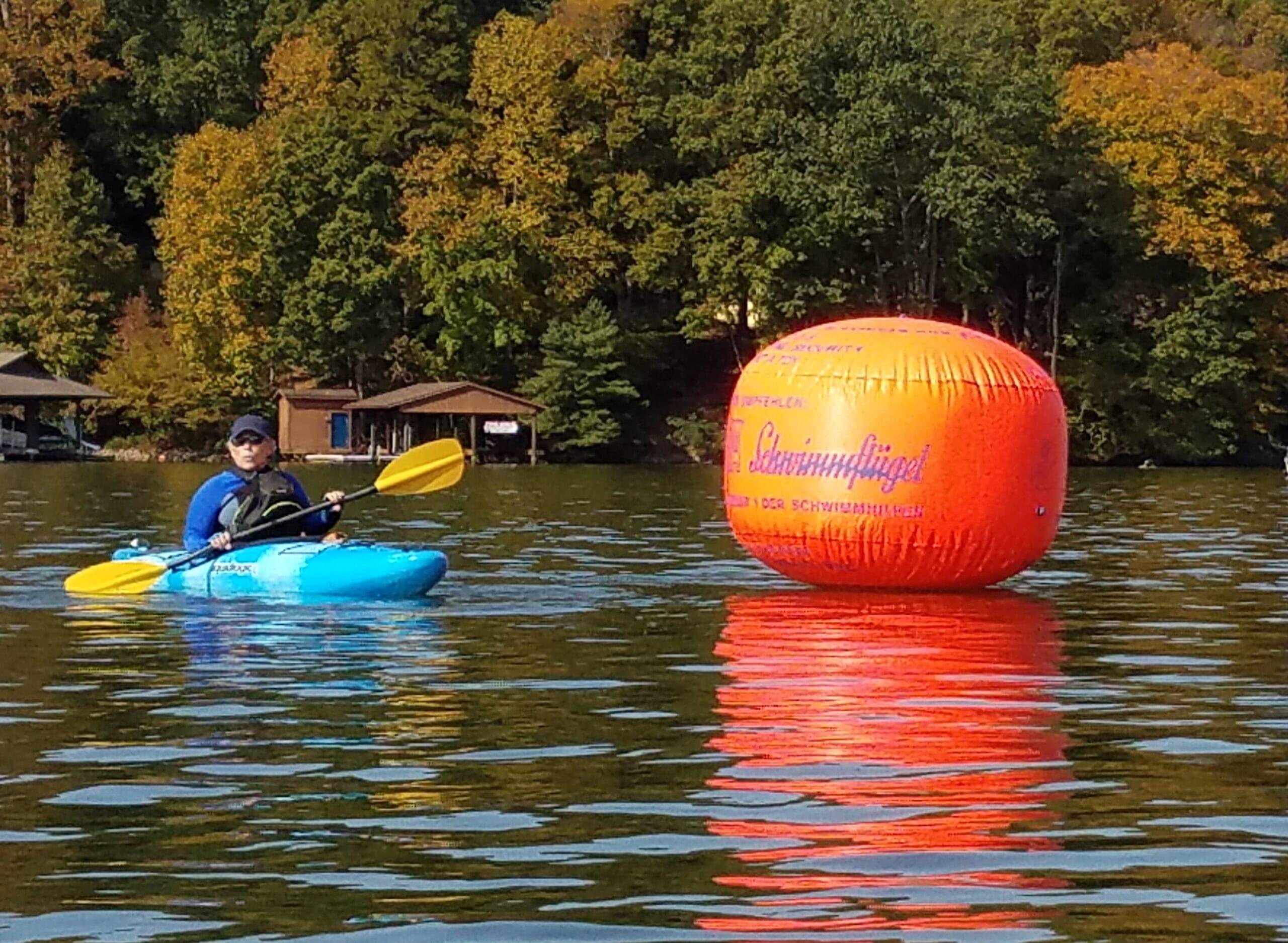 kayaker-and-orange-round-float