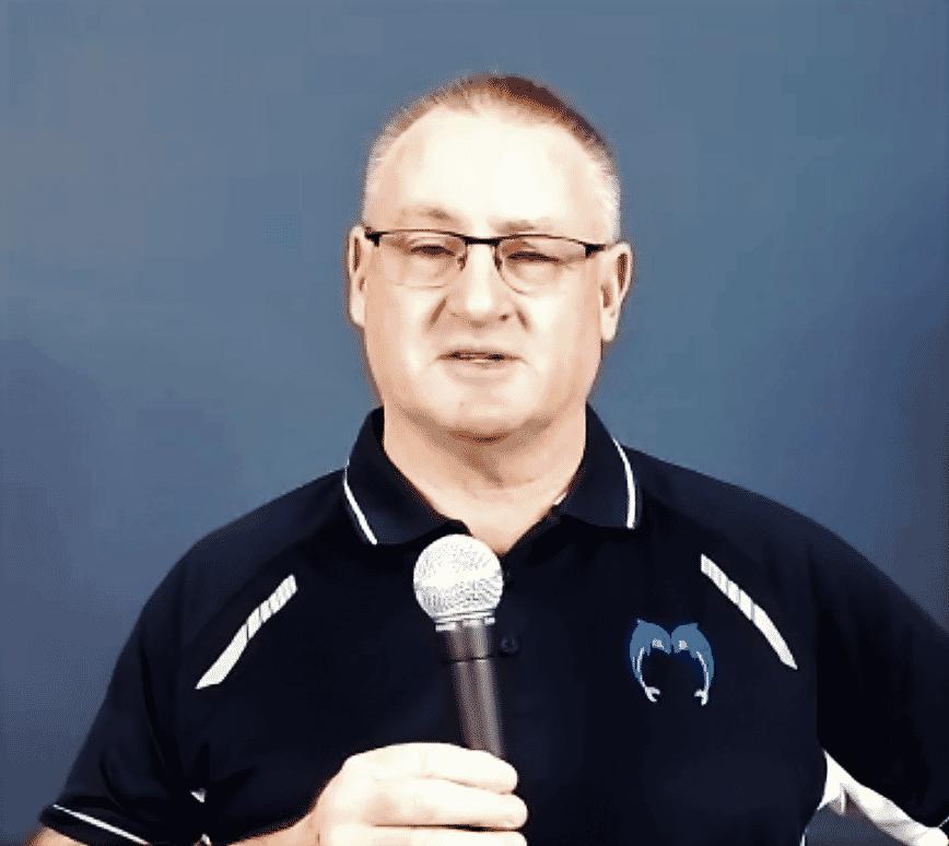 Wayne Goldsmith with microphone